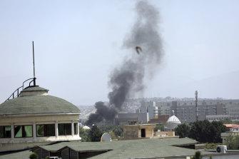 Smoke rises near the US embassy in Kabul on Sunday.