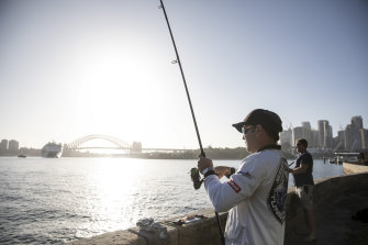 Jeremy Sims eats the fish he catches in Sydney Harbour.