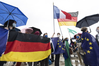 Members of pro-European French and German associations cross the Rhine River bridge that links France and Germany.