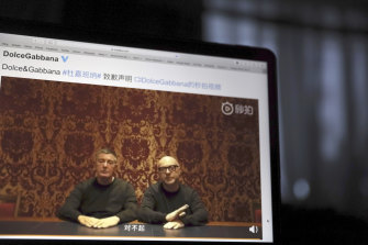 """The founders of Dolce&Gabbana Domenico Dolce, left and Stefano Gabbana apologise in a video on Chinese social media in 2018, saying """"sorry"""" in Mandarin seen on a computer screen in Beijing, China."""