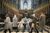People arrive to receive their COVID-19 vaccine in Westminster Abbey, London.