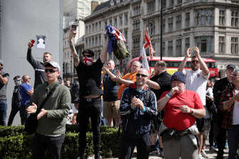 Demonstrators in front of the concealed statue of Winston Churchill in London's Parliament Square on June 13.