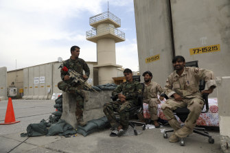 Afghan soldiers charged with guarding the base say they only knew the US troops had gone when the lights switched off.