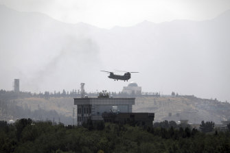 A US Chinook helicopter flies over the American embassy in Kabul, Afghanistan on Sunday.