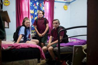 Jayde, Joel and Jordan in their bedroom before school.