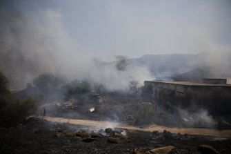 Fields burn after a rocket was fired from Lebanon into Israeli territory.