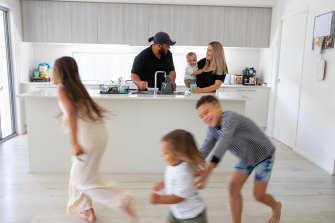April Fletcher with husband Otto holding son Draco, as Nephi, Latrell   and Nevaeh run around at the Sunshine Coast home where the moved to from Sydney.