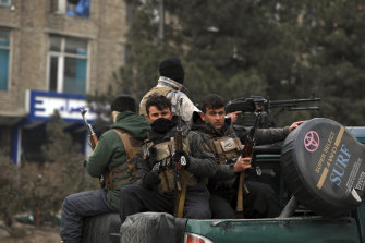 Afghan security personnel arrive at a Kabul bombsite on December 26, 2020. Journalists fear more targeted attacks during escalating violence.