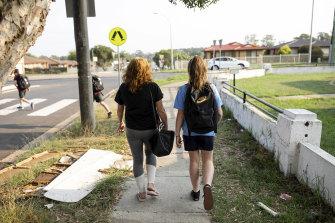 Lynette walks Jayde to school while the twins run ahead.