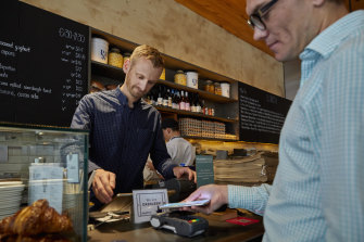 Cafe manager Chris Tate has reaped the benefits of turning his business  into a cashless operation.