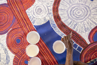 Betty Kuntiwa Pumani working on her commission, <i>Antara</i>, for The National. See it at the MCA.