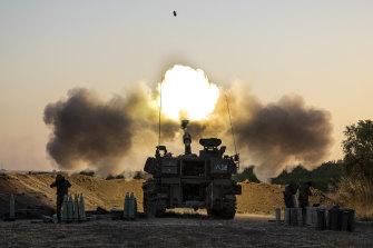 An Israeli artillery unit fires shells towards targets in Gaza Strip, at the Israeli Gaza border.