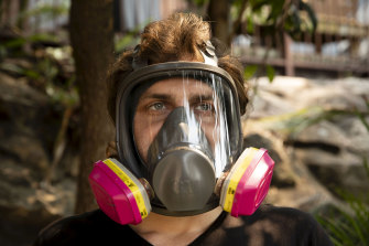 Adon Sammut, 28, from Menai has taken to wearing a P3 gas mask when outside on smoky days.