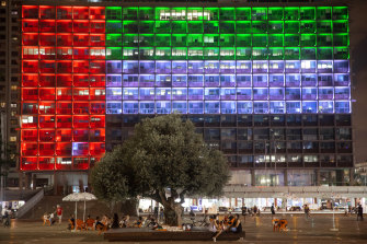 Tel Aviv City Hall is lit up with the flags of the United Arab Emirates and Israel as the countries announced they would be establishing full diplomatic ties.