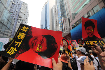 Protesters at the June 9 march with posters of Carrie Lam.