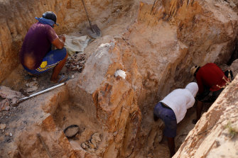 Indigenous people work in a gold mine at the Napoleao community in the Raposa do Sol reservation.