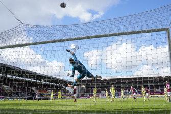 Newcastle's goalkeeper Martin Dubravka tips a Burnley shot on goal over the net at Turf Moor on Sunday.