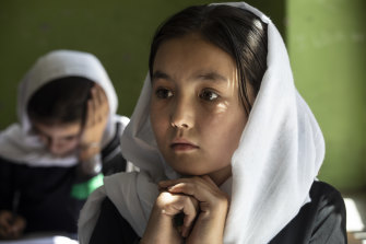 Behishta, 11, listens during 4th grade class at the Zarghoona high school for girls in Kabul. There is widespread fear the Taliban will reintroduce its notorious system barring girls and women from almost all work, and access to education.