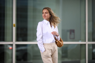 Model Isabelle Schroeder wearing a tailored shirt with joggers.