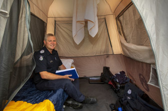 Acting Senior Sergeant Colin Shepherd in his tent at Cann River.