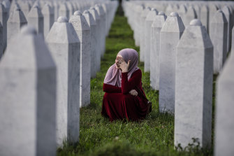 A Bosnian Muslim woman cries at the graves of relatives in Srebrenica on the anniversary of the massacre.