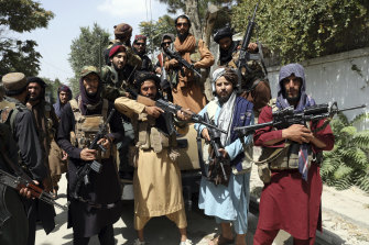 Taliban fighters pictured in Kabul on Thursday.