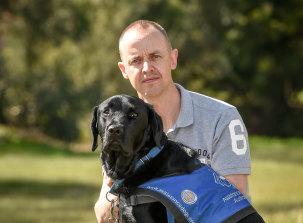 Stuart Wright and his assistance dog Frankie.