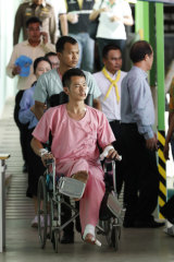Rescued tourist Huang Junxiong is wheeled back to his bed at the Vachira Phuket Hospital.
