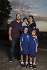 Anas Sharro with his wife Ishtar Sarkes and their children, Marcella, one, and six-year-old twins Jolly and Mary.