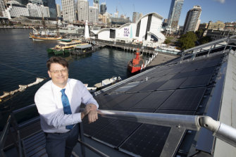 Kevin Sumption, the director and chief executive of the Australian National Maritime Museum, on the roof of the institution's Wharf 7 building where the solar panels have been installed.