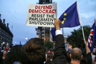 Anti-Brexit activists protest in front of the Houses of Parliament in London.