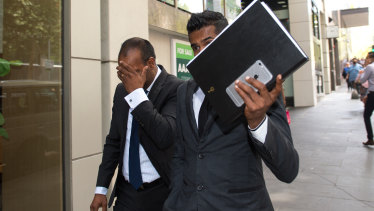 Atkinson Prakash Charan (left) outside court.