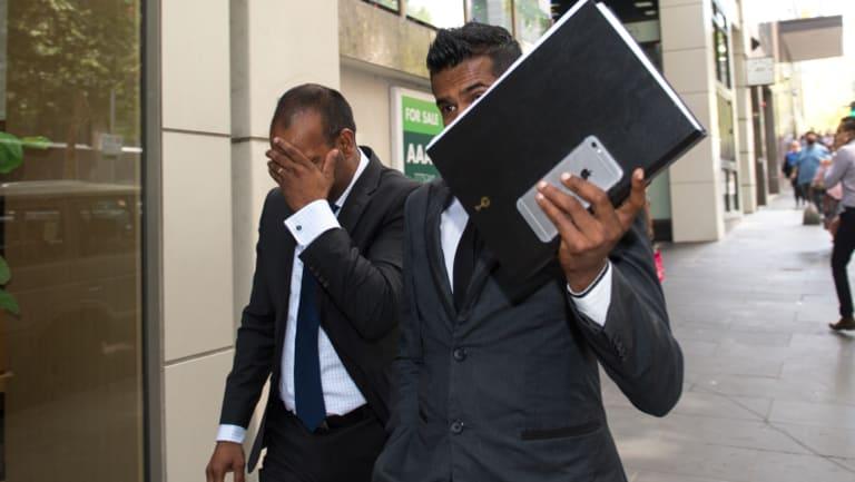 Atkinson Prakash Charan (left) outside court.