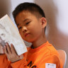 "A boy reading ""Once"", a book by  Morris Gleitzman at Beijing Happy Space."