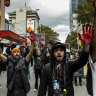 Protesters march in Melbourne to mark the 30th anniversary of the deaths in custody royal commission.