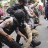 Stranded Afghans defy Jakarta lockdown to beg Australia to take them