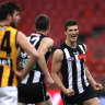 Brody Mihocek celebrates a goal for the Magpies in their win over Hawthorn at Giants Stadium.