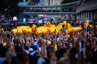 Protesters carry inflatable ducks at the Ratchaprasong Intersection in Bangkok, Thailand, on Thursday.