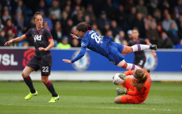 Reading goalkeeper Grace Moloney earned a red card for this first-half foul on Sam Kerr.
