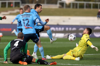 Western United goalkeeper Ryan Scott denies Kosta Barbarouses.