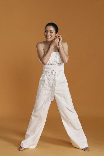 Kumi wears Esse Studios top, Oroton pants, Holly Ryan earrings.
