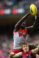 Fresh Blood: Sydney's Aliir Aliir marks over Aaron Vendenberg of the Demons.