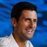Djokovic shares a laugh with the media at Melbourne Park.
