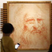 Visitors pass a portrait of Leonardo da Vinci in Rome on the 500th anniversary of his death.