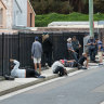 Struggling Sydneysiders line up for a free lunch outside Matthew Talbot Hostel in Woolloomooloo.