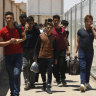 The long trip home: Afghan boys cross back from Iran as sanctions bite