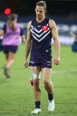 Nat Fyfe leaves the field injured during the round 4 match between the Gold Coast Suns and Fremantle.