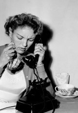 Australian war bride, Mrs Florence Doering receives a phone call from the US on 20 November 1957.