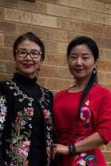 Maria (L) and Donna Wang (R), co-founders of Chinese community group Australia International Elite Cultural and Arts Centre.