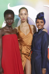 Halima Aden (right) with Australian model Adut Akech (left) and Yasmin Wijnaldum at the 2018 Business of Fashion gala.